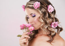 Beautiful face with pink roses Royalty Free Stock Photography