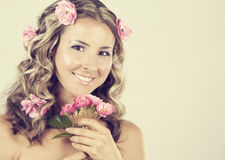 Beautiful face with pink roses Royalty Free Stock Photos