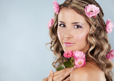 Beautiful face with pink roses Royalty Free Stock Images