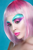 Beautiful face of puppet girl with face art in pink wig on seren Royalty Free Stock Photos