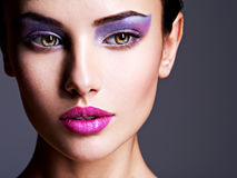 Beautiful face with purple eye make-up. fashion makeup stock photos