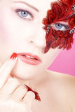 Beautiful face with red feathers Royalty Free Stock Image