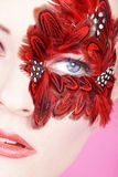 Beautiful face with red feathers Royalty Free Stock Photos