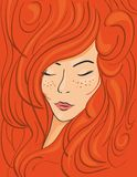 Beautiful face of a red-haired girl in thick wavy hair Royalty Free Stock Image