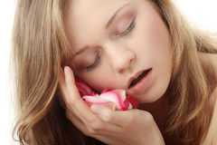 Beautiful face and rose-petal Stock Images