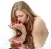 Beautiful face and rose-petal Stock Photo