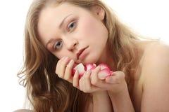 Beautiful face and rose-petal Stock Photography