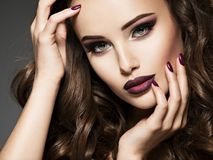 Beautiful face of sensual woman with maroon makeup. stock image