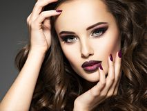 Beautiful face of sensual woman with maroon makeup. royalty free stock photography