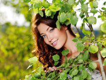 Beautiful face of the woman on the nature stock images