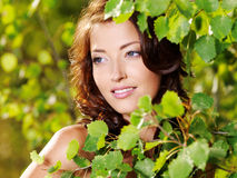 Beautiful face of the woman on the nature Royalty Free Stock Photo