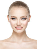 Beautiful face of smiling  woman with clean fresh skin Royalty Free Stock Photo