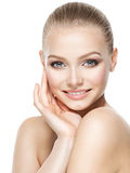 Beautiful face of smiling  woman with clean fresh skin Royalty Free Stock Images