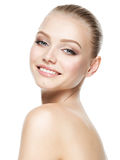 Beautiful face of smiling woman with clean fresh skin stock image