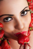 Beautiful face in strawberry Royalty Free Stock Photo