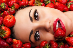 Beautiful face in strawberry Stock Photography