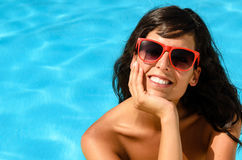 Beautiful face and swimming pool Stock Photos