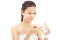 Beautiful face of woman applying moisturize cream Royalty Free Stock Photography