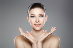 Beautiful face of woman with blue eyes and clean fresh skin. Spa portrait. Beautiful woman`s face with blue eyes and clean fresh skin. Spa portrait Royalty Free Stock Photo
