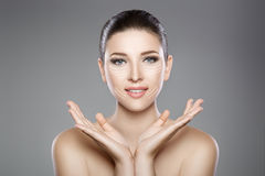 Beautiful face of woman with blue eyes and clean fresh skin. Spa portrait. Beautiful woman`s face with blue eyes and clean fresh skin. Spa portrait Royalty Free Stock Images