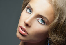 Beautiful face of a woman with blue eyes Stock Images