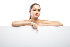 Beautiful face of woman with clean skin isolated. Beautiful face of young adult woman with clean fresh skin pointing on something isolated on white. Space For stock image