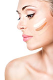 Beautiful face of  woman with cosmetic foundation on a skin. Stock Images