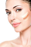 Beautiful face of  woman with cosmetic foundation on a skin. Royalty Free Stock Photo