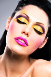 Beautiful face of a woman with fashion makeup Stock Images