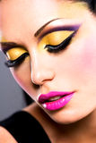 Beautiful face of a woman with fashion makeup Royalty Free Stock Photo
