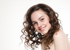 Beautiful face woman freckles and curly fly hair. Nice smile portrait Royalty Free Stock Images