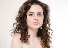 Beautiful face woman freckles and curly fly hair. Nice smile portrait Stock Image