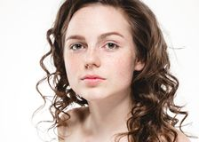 Beautiful face woman freckles and curly fly hair. Nice smile portrait Royalty Free Stock Photos