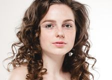 Beautiful face woman freckles and curly fly hair. Nice smile portrait Stock Images