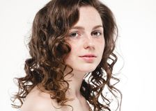Beautiful face woman freckles and curly fly hair. Nice smile portrait Royalty Free Stock Photography