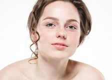 Beautiful face woman freckles and curly fly hair. Nice smile portrait Royalty Free Stock Photo