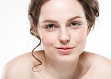 Beautiful face woman freckles and curly fly hair. Nice smile portrait Stock Photo
