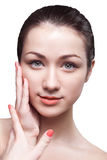 Beautiful face of young adult woman with clean fresh skin Stock Photography
