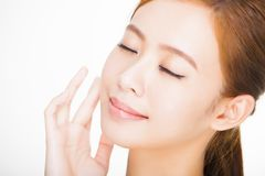 Beautiful face of young adult woman with clean fresh skin. Skin care concept Stock Photos