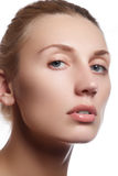 Beautiful face of young adult woman with clean fresh skin - isolated. Beautiful girl with beautiful makeup, youth and skin care co Royalty Free Stock Image