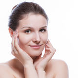 Beautiful face of young adult woman with clean fresh skin - isolated on white Stock Image