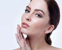 Beautiful face of young adult woman with clean fresh skin - isolated on white Royalty Free Stock Images