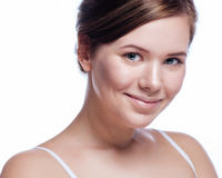 Beautiful face of young adult woman with clean fresh skin - isolated on white Royalty Free Stock Photo