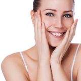 Beautiful face of young adult woman with clean fresh skin. On white stock photography