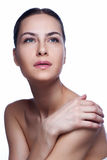 Beautiful face of young adult woman with clean fresh skin -  on white Royalty Free Stock Images