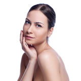 Beautiful face of young adult woman with clean fresh skin -  on white Royalty Free Stock Photo