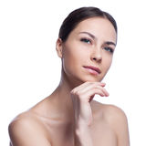 Beautiful face of young adult woman with clean fresh skin -  on white Stock Images