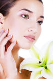 Beautiful face of young asian woman with big lily. Royalty Free Stock Images