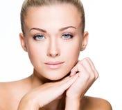 Beautiful face of a young caucasian woman Stock Photos