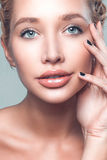 Beautiful face young caucasian woman touch clean skin Stock Photo